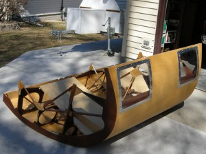 Finished lower-front pilot pod fairing.  Note Renegade Iceboat trailer in the background